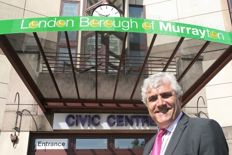 Councillor Stephen Alambritis stands outside the London Borough of Murrayton civic centre
