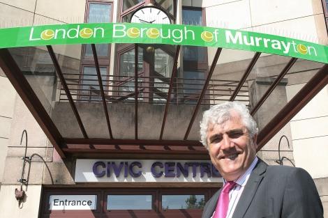 Councillor Stephen Alambritis stands outside the London Borough of Murrayton civic centre