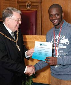 Gogocha Lema-Lopes picks up his award from former Mayor of Merton, Councillor David Williams, earlier in the year