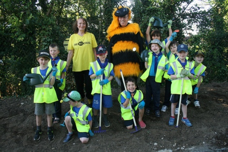 The local 5th Morden Beaver Group and Friends of the Earth volunteers help to plant the seeds for the new Bee Worlds