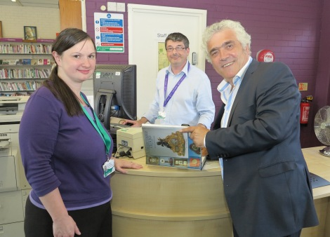 Leader of Merton Council, Councillor Stephen Alambritis with staff at Donald Hope Library