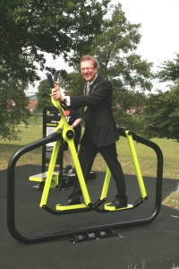 Deputy Mayor tries out new outdoor gym.