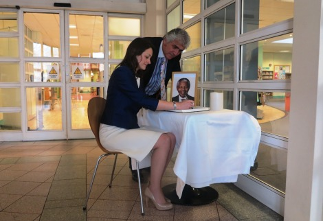 Mayor of Merton, Cllr Krystal Miller and Leader of the council Cllr Stephen Alambritis sign a book of condolence for Nelson Mandela