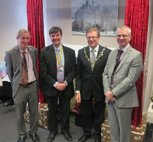 Head of Library and Heritage Services Anthony Hopkins, cabinet member for community and culture Cllr Nick Draper, Deputy Mayor Cllr John Sargeant and Chief Executive Ged Curran unveil an old photo of Wimbledon Library to mark the library's new look and facilites