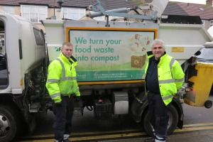 Leader of Merton Council, Councillor Stephen Alambritis helps with the food waste collection