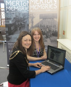 Heritage and Local Studies manager Sarah Gould shows the Mayor of Merton Cllr Krystal Miller through the new website