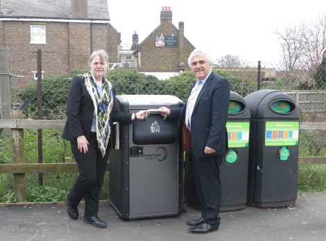 Cllr Judy Saunders and Cllr Stephen Alambritis with one of the new smart bins on Tramway Path, London Road, Mitcham