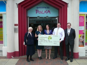 Mayor Councillor Krystal Miller and Deputy Mayor Councillor John Sargeant present the Polka Theatre with the cheque at a celebration event