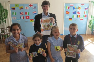 Merton Abbey Primary School Asifa Nasar, Elina Guida, Summer Fieldhouse and Bailey Stanford-Shepard pupils signing up to the challenge with Councillor Nick Draper