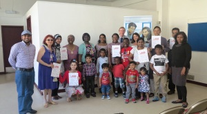 Mayor of Merton Councillor Agatha Akyigyina with library users who completed the Six Book Challenge