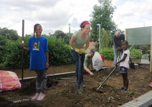 Phipps Bridge sisters Roqayah Jones and Tasharra Kerr with Sustainable Merton's Michelle Kolattek