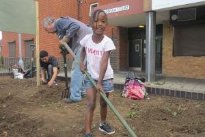 Roqayah Jones helps out at the Dig Merton scheme in Phipps Bridge