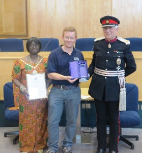 John Goddard with Mayor of Merton Councillor Agatha Akyigyina and The Right Honourable Sir John Wheeler, accepting the Queen's Award for Voluntary Service on behalf of Merton Street Pastors