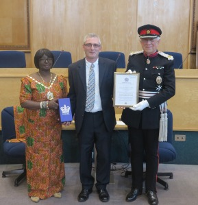 Pastor Kevin Vickers with Mayor of Merton Councillor Agatha Akyigyina and The Right Honourable Sir John Wheeler , accepting the Queen's Award for Voluntary Service on behalf of The Jeremiah Project