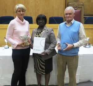 Mayor Councillor Akyigyina presents Mr and Mr Prior with the London Borough of Merton Challenge Trophy - Best in Merton award