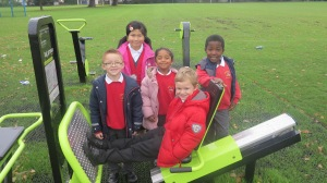 Children from Abbotsbury Primary School try out the new green gym at Morden Rec