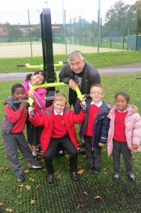 Councillor Andrew Judge with pupils from Abbotsbury Primary School at the new green gym in Morden Rec