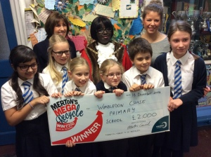 Mayor of Merton, Councillor Agatha Akyigyina  with Headteacher of Wimbledon Chase Primary School, Sue Tomes (left) and pupils.