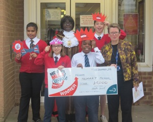 Mayor of Merton, Councillor Agatha Akyigyina, Pelham Primary School Headtecher Maria Keenan and children at Pelham Primary School