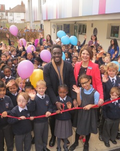 Blue Peter presenter Andy Akinwolere and Cranmer Headteacher Ruth Whymark (centred) with pupils