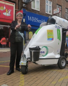 Councillor Judy Saunders with one of the new Glutton machines in Mitcham town centre