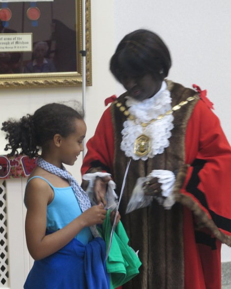 Winner of the logo design competition Stella Kanoti Rodriguez receiving her certificate from Mayor of Merton Cllr Agatha Akyigyina