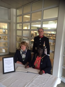 Mayor of Merton Cllr Agatha Akyigyina with Sir David Brewer, HM Lord Lieutenant of Greater London and Claire Whelan OBE, incoming representative Deputy Lieutenant for the London Borough of Merton leaving their messages of support