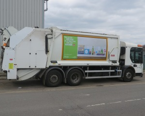 New recycling banner on a refuse vehicle.