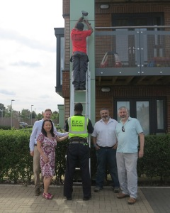 Cabinet member for environmental sustainability and regeneration, Councillor Andrew Judge alongside Brenley Park Residents' Association's Chair, Gitte Joergensen and local residents having their CCTV cameras installed.