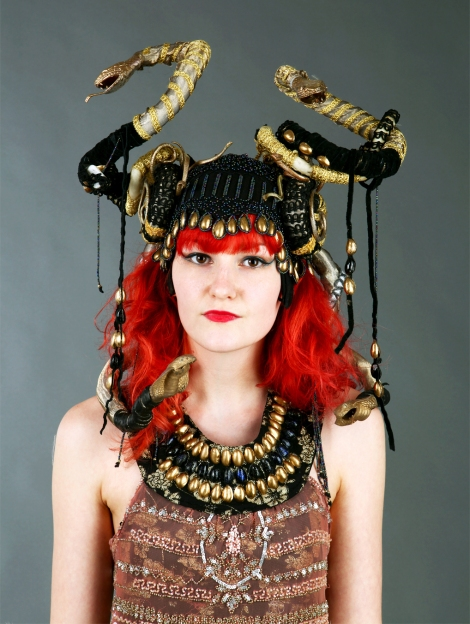 Becky Williams from Wimbledon College of Art's 1920 flapper girl combines Art Deco with Medusa/Egyptian influences. The headdress is decorated with spray-painted pistachios and the dress is recycled fabrics and pistachio decoration.