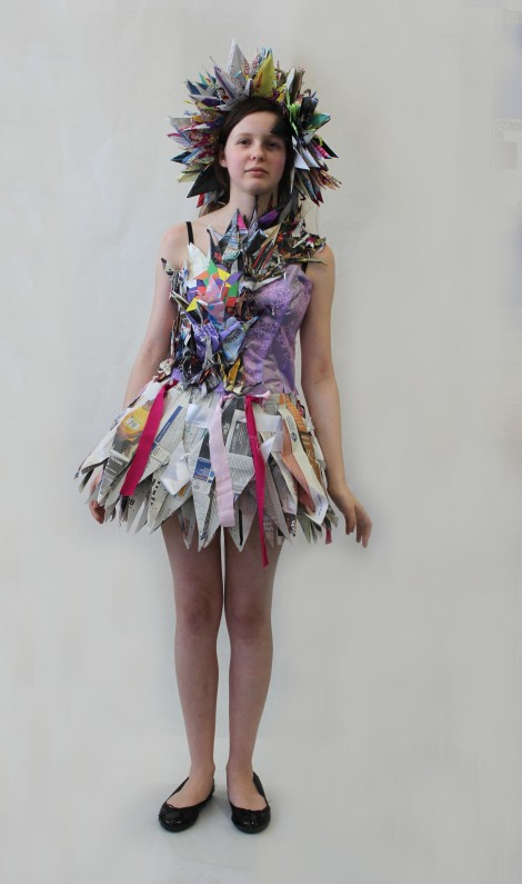 Jude Ruth Furey from Ursuline High School's costume celebrates the life of 12 year old Sadako Sasaki, a Japanese girl who suffered from leukaemia after the atomic bomb was dropped on Japan. She wanted to make 1000 origami cranes before she died as she wished for peace. She only folded 644. The costume is made from newspapers, magazines,wrapping paper, flower wrapping, and scrap fabric.