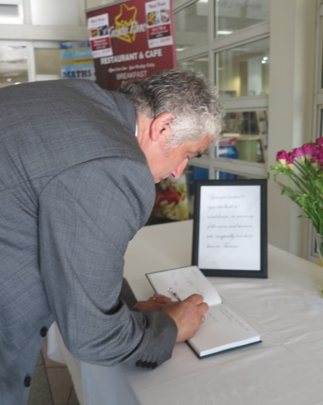 Leader of Merton Council Cllr Stephen Alambritis signing the book of condolence at the civic centre