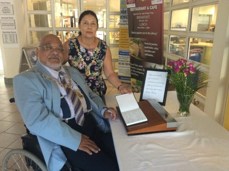 Mayor of Merton, Cllr David Chung with the Mayoress Mrs Irina Chung, signing the book of condolence at the civic centre