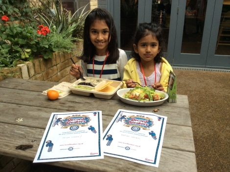Prisha with her sister celebrating completing the summer reading challenge 2015 at Chipoltle