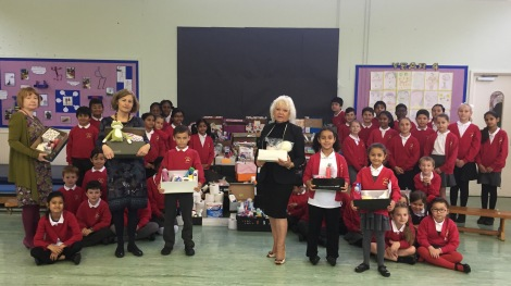 Abbotsbury School Council with all the donations they have collected. (L-r) Yvette Stanley (Director of Children, Schools and Families at Merton Council), Jackie Schneider (teacher at Abbotsbury) and Cllr Maxi Martin went along to see the work the children had done in gathering donations