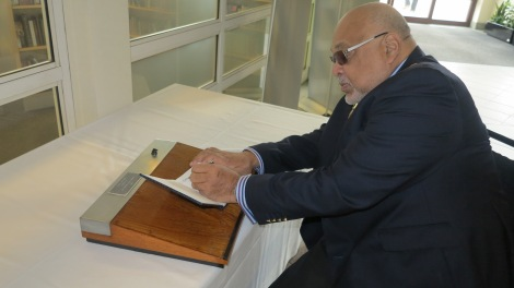 The Mayor of Merton, Cllr David Chung signing the book of condolence