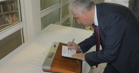 The Leader of the Council, Councillor Stephen Alambritis signing the book of condolence