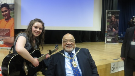Lillie Rodger, seen here with the Mayor of Merton, played and sang a song she wrote about her expedition