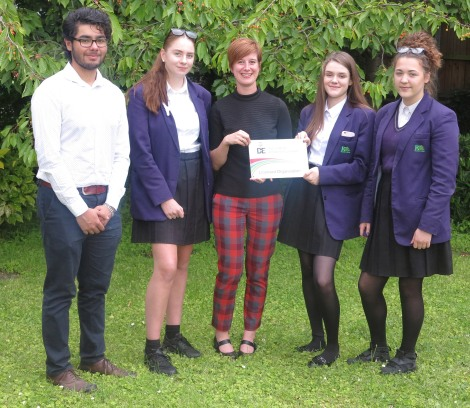 Photo shows (left to right): Hamid, Skye, Cllr Katy Neep, Beth and Sandra with the Duke of Edinburgh's award scheme plaque, presented to the council at Buckingham Palace earlier this year