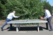 Leader of the council, Cllr Stephen Alambritis and cabinet member for community and culture Cllr Nick Draper try their hand at table tennis in Joseph Hood Rec