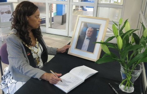 Mayor of Merton Cllr Brenda Fraser signing the book of condolence in memory of The Reverend Doctor Andrew Wakefield DD