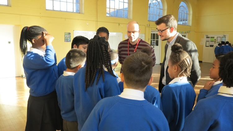 Pupils at St Thomas of Canterbury School talking to Cllr Ross Garrod about their work on litter and their play around environmental crime