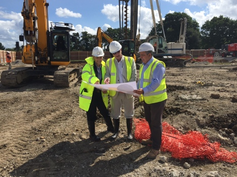 (L-r): Chris Parsloe (Merton Council) with Cllr Nick Draper and Pallikaan site manager Millad Yousif looking at the plans on site