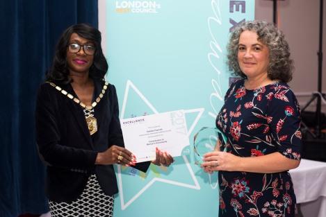 Debbie Fawcett receiving her award from Mayor of Merton Cllr Marsie Skeete