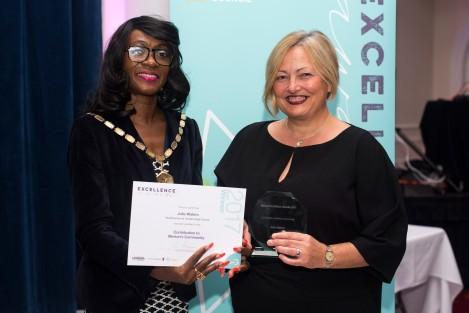 Julia Waters receiving her award from Mayor of Merton Cllr Marsie Skeete