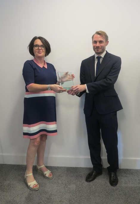 Coucillor Tobin Byers receiving award from Linda O_Sullivan, Head of London and South Region at Alzheimer_s Society